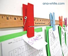 Children's art and paper display. Ruler and giant paperclips. Easy DIY