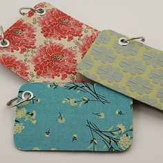 fabric remnant notebooks...recycle cereal box cardboard, scraps, use eyelets, rings, paper of choice.  simple. C.