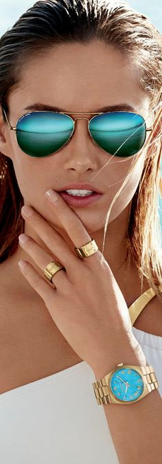 You definitely need a nice pair of shades for your honeymoon at a tropical location. Shades and accessories by Michael Kors.