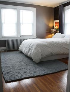 Emily's Rochester Merrypad Bedroom from ApartmentTherapy. Grays and a simple layout, perfect.