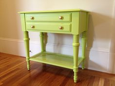 Bright green side table with cane shelf and gold knobs
