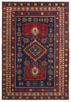 Caucasian Lambalo Kazak - 5ft 8in x 8ft 2in, 3rd Quarter, 19th Century. Noteworthy for its original design incorporating pinwheel motifs around the edge of the field, this striking Lambalo Kazak carpet is a collectible antique Caucasian rug. Dynamic serrated pendants, rendered in saturated carnelian, anchor a mesmerizing diamond central medallion while three borders using time-honored symbology complete this compelling work. Sensitive abrash color striation appears throughout field & borders