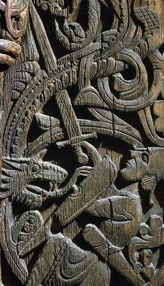 sigurd (or siegfried) slays the dragon fafnir. a 12th century wood piece from a church in setesdal, norway.