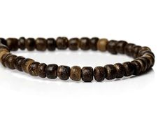 These beads are made of coconut wood and measure 4mm in diameter.Coconut beads are considered ecological because they use a renewable resource and are biodegradable.Quantity: 1 strands of approx. 140 beads - 15 6/8 inches (40cm long)Color: brownMaterial: wood coconutSize: 4mm diam.Thickness: 4.5mm ( 1/8