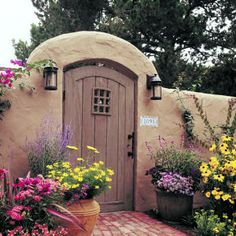for late summer color - Southwest Living - enjoy projects incorporating windows and doors. The flowers give me ideas.- Southwest Living - enjoy projects incorporating windows and doors. The flowers give me ideas. Garden Entrance, Garden Doors, Garden Gates, Fence Gates, Style Hacienda, Parrilla Exterior, Outdoor Spaces, Outdoor Living, Wooden Garden Gate
