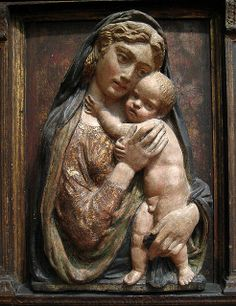 Madonna and Child - Manner of Donatello -  Italian, Florentine.Madonna and Child - Gilded and polychromed terracotta, on wood background.