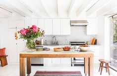 A slab of marble previously used for still-life photo shoots was transformed into a rolling kitchen island. Because the house is relatively narrow, Jenni wanted to have the option to move the island rather than install it in a fixed location.