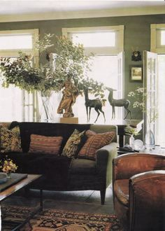 """Calling the look """"Swamp Palazzo,"""" interior designer Rosemary James has packed her tiny New Orleans house with amazing French furniture. The dining room is painted a shade she calls """"Empire Green."""" I love the simplicity of the bare plank floors and the per Living Room Green, Green Rooms, My Living Room, Home And Living, Living Spaces, Green Walls, Green Sofa, Cottage Living, French Furniture"""
