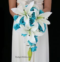 Turquoise roses with beautiful white Casablanca lilies in a cascading bouquet