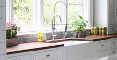 white kitchen - by susan serra (farm sink, white cabinets, love the commercial looking faucet, possibly mahogany counters? or beech?  pretty)