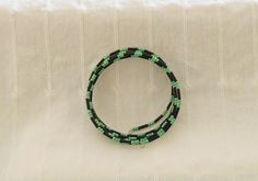 Black and green seed bead memory wire bangle