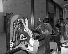 Students from Fenton Avenue Elementary School in Lake View Terrace decorate the windows of Pacoima Memorial Hospital with holiday greetings, 1982. It was an annual tradition in its eighth year. Teacher, Leslie Dwiggins, pictured in the background, supervised the project. Also pictured are George Cervantes, Gary Castellano, Jose Francisco Senda, and Jose Hernandez.. Robert and Betty Franklin Collection. San Fernando Valley History Digital Library.