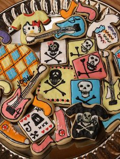Punk Rock Cookies-- I can make a stencil for the band names out of card paper and sprinkle powdered sugar over the cupcakes/cookies.