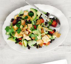 Mexican salad with tortilla croutons  Black beans make a great salad base - mix them with avocado, tomatoes and coriander Latin American style