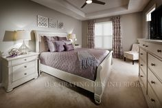 We chose soft grey's and purples with a creamy grey finish on the furniture.