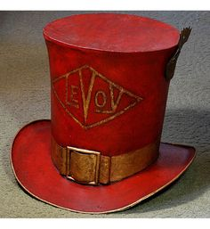 What fun! A French large red tole model of a top hat with a raised buckle.