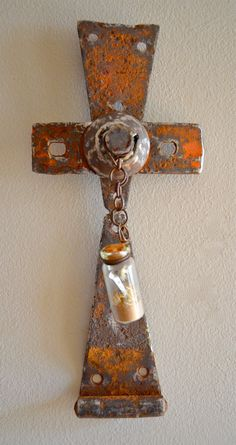 Holy Healing, a cross made from recycled barn hinges and other farm scrap iron