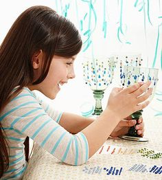 At the party, kids can turn plastic goblets into royal drinking glasses using self-adhesive jewels.                 Originally published in the March 2014 issue of FamilyFun