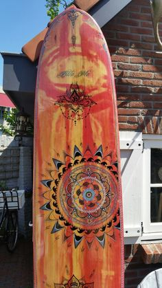Posca art on wooden surfboard , mandala