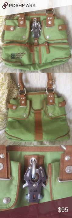 George Gina Lucy handbag 100%authentic green George Gina Lucy hand bag. Model 'Butterfly Charme'. Used twice therefore in excellent used condition. Plenty of compartments for easy organizing. Size is expandable. Bags