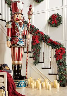 At over 9 feet, this stately nutcracker stands tall in his dress uniform, complete with stately hat and his staff at the ready. Crafted of polyresin with a handpainted finish, this nutcracker is adorned with multicolored LED lights that create a festive after-dark display.