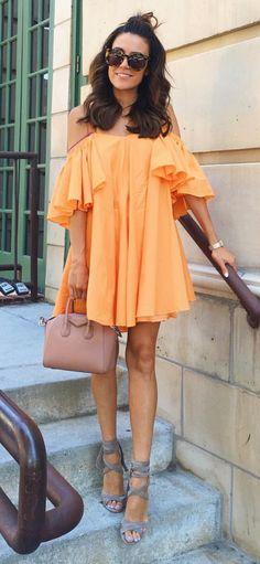 Tangerine off-shoulder dress.