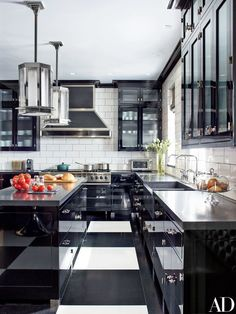 Pendant lights by Steven Gambrel for the Urban Electric Co. hang in the kitchen, which features walls sheathed in Urban Archaeology tile and cabinetry by Gambrel and Arcologica   archdigest.com