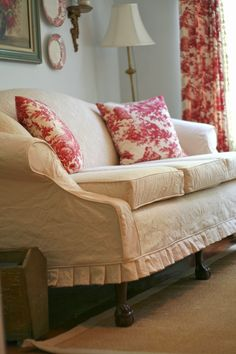 Pleated Slipcovered Sofa - the slipcover was made from a vintage quilt and canvas.  Sofa and fabrics were all yard sale finds - what an amazing job! - Custom Slipcovers by Shelley:  Vintage Quilt Couch