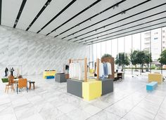 The pop up furniture exhibition by Jo Nagasaka / Schemata Architects installed in the lobby of a Tokyo building coexists with the regular business activities.