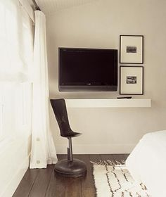 I think the arrangement of the TV with the pictures and a simple ledge underneath is really elegant. From Erin Martin Design Tv In Bedroom, Master Room, Bedroom Decor, Interior Design Inspiration, Decor Interior Design, Lovely Apartments, Closet Remodel, Decorating Small Spaces, Home Projects