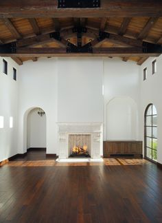 beams.wood floors.high ceiling. arches.crisp walls.fireplace.perfection.