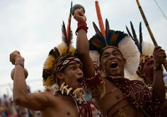 Brazilian Pataxos natives celebrate their victory in the sport of archery on Oct. 25, in Palmas, Brazil. (Buda Mendes/Getty Images)
