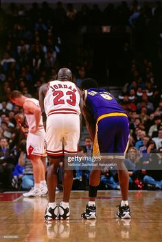 Michael Jordan #23 of the Chicago Bulls stands on the court during a game against Kobe Bryant #8 of the Los Angeles Lakers on December 17, 1997 at Chicago Stadium in Chicago,