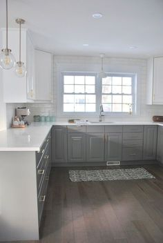 white shaker cabinets with quartz countertops. a gray and white kitchen makeover using ikea cabinetry, quartz countertops, subway tile, shaker cabinets with countertops