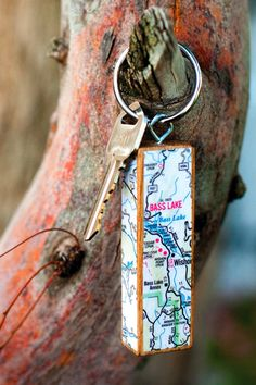 Jenga key chain using travel map or wrapping paper.