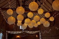 Fairy light canopy with cream lanterns at Tewin Bury Farm