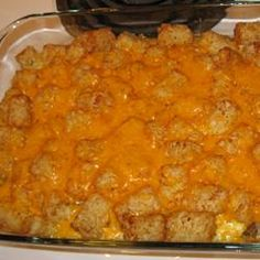 Tater Tot Breakfast Casserole     Ingredients     1 pound ground pork breakfast sausage      2 cups shredded Cheddar cheese      2 cups milk      2 eggs      2 pounds tater tots