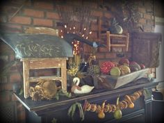 My collection of antique decoys and vintage youth chairs on my mantle. Ye olde crow primitives