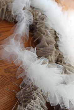 This would be GREAT for Halloween! Change tulle to Orange.do it yourself divas: DIY: Burlap Garland and Tulle Garland All Things Christmas, Winter Christmas, Christmas Holidays, Christmas Decorations, Christmas Ornaments, Burlap Christmas, Tree Decorations, Diy Christmas Tree Garland, Woodland Christmas