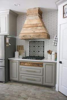 I recently did a renovation on my kitchen, and one of the most dramatic changes was the space over my stove. I decided to rip it out and build a whole new vent hood, and I love the results! Check out how this DIY Modern Farmhouse Vent Hood turned out! Kitchen Cabinets And Backsplash, Kitchen Vent, Kitchen Hoods, Backsplash Ideas, Farmhouse Kitchen Island, Modern Farmhouse Kitchens, Industrial Farmhouse, French Farmhouse, Farmhouse Table