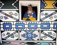 Africa |  Ndebele woman looking out of the window of her home in South Africa. | ©Jim Zuckerman.