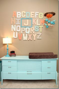 I love this idea of framing your child's initial in a wall alphabet! or making them all a neutral color except their initials in a bright vibrant color