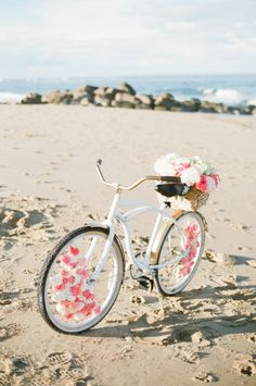 A beach cruiser covered in flowers is a must have for a warm weather wedding.