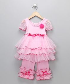 Ruffles galore! Tiny fans of frill will adore this sweet dress and pants set that's covered top to bottom with rows of frill. Sheer glittery sleeves and a rosette embellishment are just lovely little bonuses.