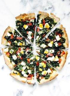 Kale and Ricotta Breakfast Pizza — with fried eggs swapped out for hardboiled ones
