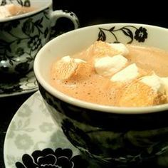 "Creamy Hot Cocoa | ""Mmmmm... This recipe belongs in front of a crackling fireplace on a snowy night. Sweet, creamy, chocolatey- truly a gourmet hot cocoa!"""