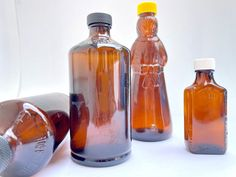 Excited to share this item from my #etsy shop: Vintage Lot of 4 – Brown Amber Glass Bottles, Aunt Jemima Syrup, Duraglas Medicine and 2 Health-Ade Kombucha Bottles #brown #vintageamberglass #amberglassbottles #collectibleglass #collectiblebottles #auntjemimabottle #mrsbutterworth #kerrsyrupbottle #figuralbottle Kombucha Bottles, Oval Logo, Aunt Jemima, Art Deco Vanity, Amber Glass Bottles, Vintage Medical, Medicine Bottles, Pink Depression Glass, Glass Collection