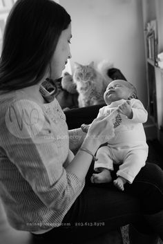 newborn and mom with cat | PROFESSIONAL PORTRAIT PHOTOGRAPHER | ninapomeroy.com | Connecticut Family Photos | environmental newborn baby | black and white | in home photographer