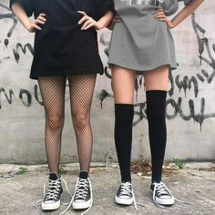 Both are cute, fishnets, converse, t shirt dress (concert outfit?) tshirt dress, thigh highs, converse