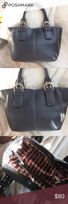 """Tignanello Expandable Black Leather Handbag 👜 This purse has been gently preloved, but is still in great condition!  It has snaps in the inside that can take it from the shape in the first two pics to the one in the last pic.  It's a nice small Handbag that can fit a lot!  The dimensions measure about 7.5"""" x 8.75"""" x 7"""".  The handles measure about 15"""". Tignanello Bags Satchels"""